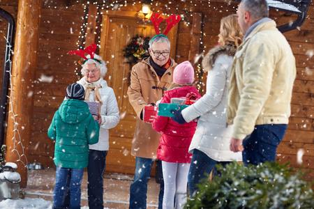 Photo pour Happy grandparents at Christmas eve gathering family - image libre de droit