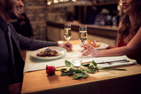 Photo for Couple have romantic evening in restaurant - Royalty Free Image