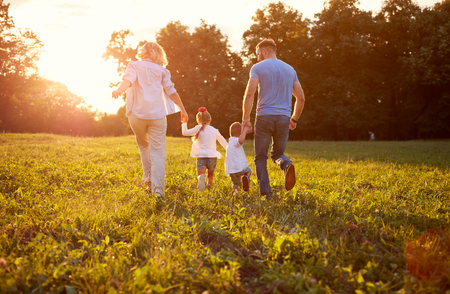 Photo pour Family running together Family in nature, back view - image libre de droit