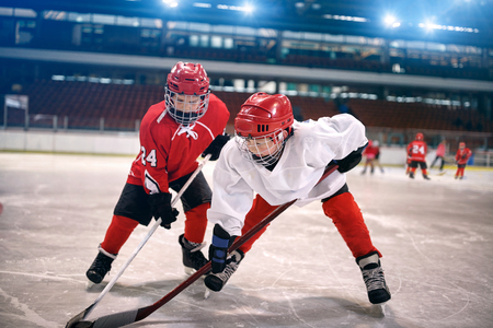 Photo for young children play ice hockey - Royalty Free Image