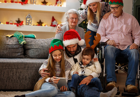 Photo for Family with grandma and grandpa enjoy together in Christmas eve - Royalty Free Image