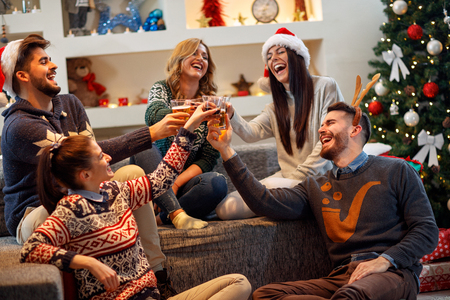 Photo for Group of friends having fun on Christmas Party - Royalty Free Image