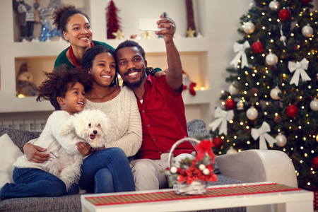 Foto de Christmas selfie - Afro American family making together selfie - Imagen libre de derechos