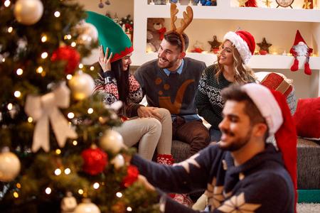 Foto de young friends having fun and celebrating Christmas   - Imagen libre de derechos