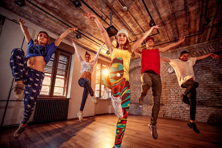 Photo for Young modern dancing group practice dancing in jump. Sport, dancing and urban culture concept - Royalty Free Image