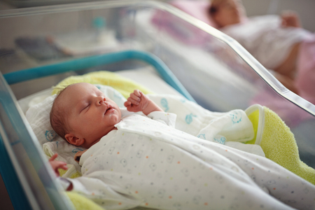 Foto de New born male baby in maternity hospital - Imagen libre de derechos