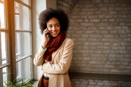 Cute Afro-American girl talking on cell phone