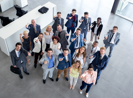 Portrait of waving business people