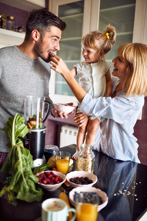 Foto de Family with child taking healthy meal at morning - Imagen libre de derechos