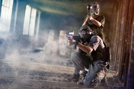 Photo for Paintball team together shooting in camouflage wear - Royalty Free Image