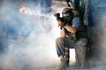 Photo for Paintball team shoot, defending action - Royalty Free Image