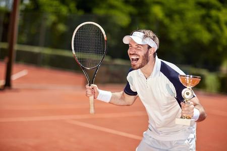 Photo pour Delight male winner in tennis match - image libre de droit