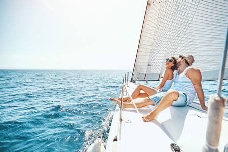 Photo pour Young man and woman Relaxing on a Yacht in the summer. - image libre de droit