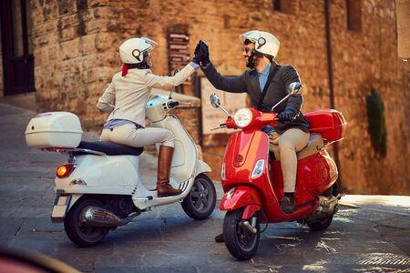 Photo pour Young Italian Couple on Vespa Scooter. Bikers couple. - image libre de droit