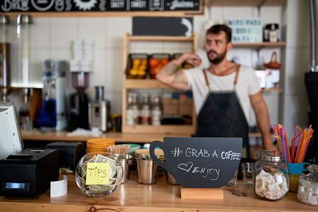 Photo for New open coffee bar. Owner working at new open cafe - Royalty Free Image
