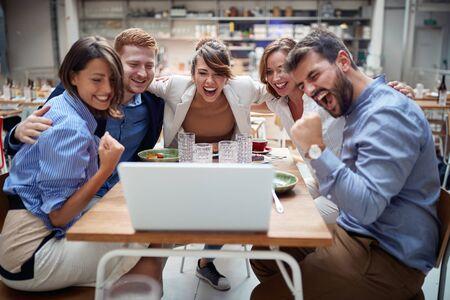 Photo pour Business People Celebrating Success at the coffee shop together. - image libre de droit