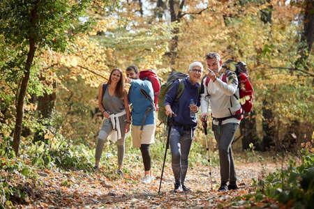 Photo pour Family trekking in the woods; Quality family time concept - image libre de droit