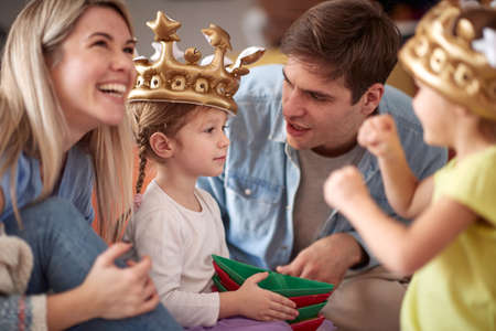 Photo pour Young family having wonderful time in a cheerful atmosphere at home together. Family, playing, home, togetherness - image libre de droit