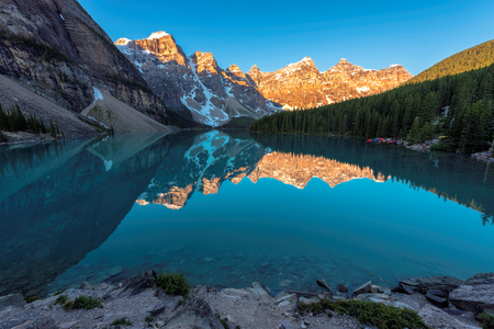 Beautiful turquoise waters of the Moraine lake at sunrise in Banff National Park of Canada