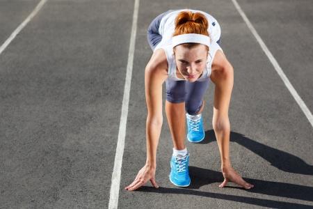 Woman getting ready to start on Stadium - summer outdoors training