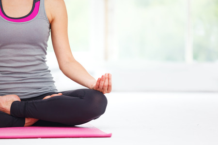 Photo for Young beautiful woman doing yoga indoors. - Royalty Free Image
