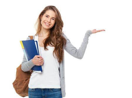 Foto de Portrait of happy student showing something isolated on white background. - Imagen libre de derechos
