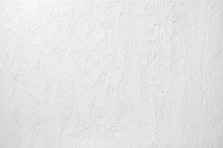 Foto de Photo of a white plastered wall. Abstract background - Imagen libre de derechos