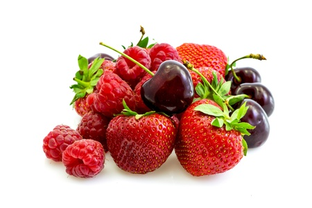 Foto de a few pieces of fresh red fruits - strawberries, raspberries, cherries - Imagen libre de derechos