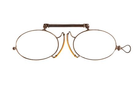 Antique pince-nez is on white background