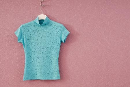 Photo pour turquoise female tee-shirt is on coat-hanger - image libre de droit