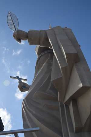 Foto de SANTA CRUZ, BRAZIL - September 25, 2017 - View of the courtyard of the largest Catholic statue in the world, the statue of Saint Rita of Cassia, 56 meters high, located in the northeastern backlands. - Imagen libre de derechos