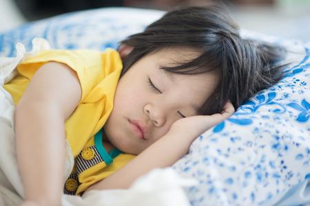 Foto de Cute asian baby sleeping on bed - Imagen libre de derechos