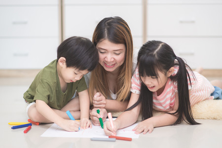 Photo for Asian family drawing picture with crayons - Royalty Free Image