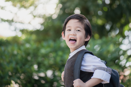 Photo for Portrait of Asian student with backpack outdoors,back to school concept - Royalty Free Image