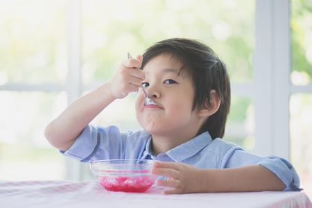 Foto für Happy little asian child eating Shaved ice at home - Lizenzfreies Bild
