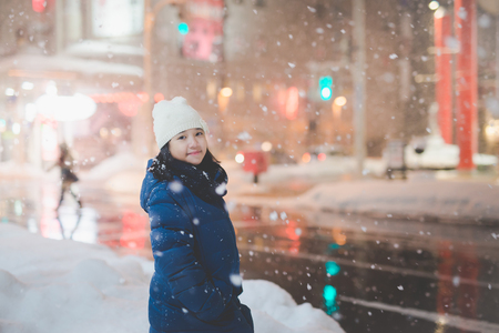 Photo for Beautiful asian girl girl in a night city snowflake ,Aomori Japan - Royalty Free Image