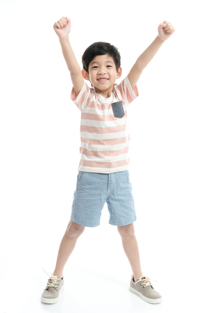 Foto de Cute Asian child showing winner sign on white background isolated - Imagen libre de derechos