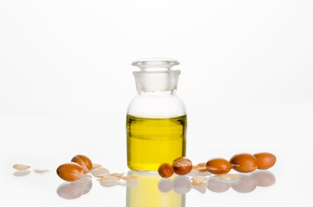 Argan oil with fruits on white background. Argan comes from ...