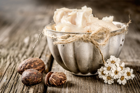 Photo for Shea butter and nuts on a wood - Royalty Free Image
