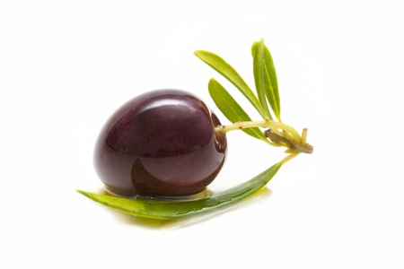 macro of a fresh olives bathed in olive oil on white background