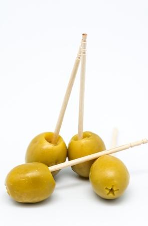 cap stuffed olives on white background
