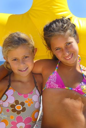 Two young girls in the beach