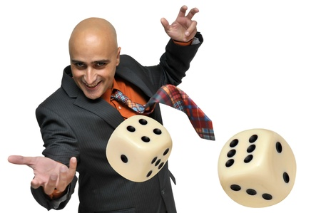 Photo pour Man in a suit playing dice isolated in white - image libre de droit