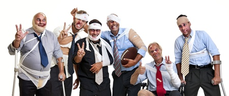 Group of injured businessmen after a rugby game