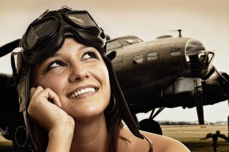 Photo pour Beautiful young pilot hat and goggles - image libre de droit