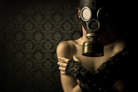 Woman with gas mask in a grunge background