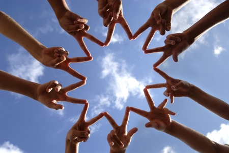 Foto de Hands together against the sky - Imagen libre de derechos