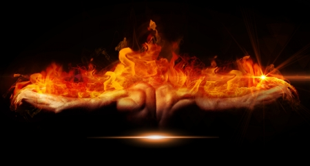 Beautiful and muscular black man's back on fire in dark background