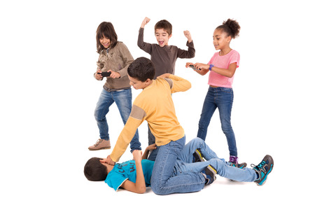 Photo for Boys fighting with other kids cheering and filming - Royalty Free Image