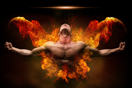 Photo for Power athletic man with great physique. Strong bodybuilder with open arms and surrounded by fire - Royalty Free Image